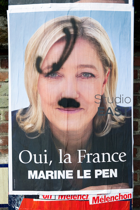 National Front leader Marine Le Pen's political poster has been painted over to make her look like Hitler, near Noyelles-Godault, France, on May 31, 2012. Noyelles-Godault is part of Henin-Beaumont's constituency disputed by Left Front Leader Jean-Luc Melenchon and National Front leader Marine Le Pen, both candidates for the June general elections in France. Photo by Lucas Schifres
