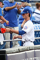 St. Lucie Mets pitcher Eric Beaulac #19 signs autographs during a game against the Charlotte Stone Crabs at Digital Domain Ballpark on June 20, 2011 in Port St Lucie, Florida.  St. Lucie defeated Charlotte 3-2 in 11 innings.  (Mike Janes/Four Seam Images)