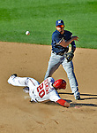 24 September 2012: Milwaukee Brewers infielder Eric Farris turns a double play on a sliding Ian Desmond during a game against the Washington Nationals at Nationals Park in Washington, DC. The Brewers fell 12-2 to the Nationals in the final game of their 4-game series, splitting the series at two. Mandatory Credit: Ed Wolfstein Photo