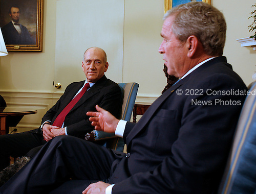 Washington, DC - November 24, 2008 -- United States President George W. Bush meets in the Oval Office of the White House with Prime Minister Ehud Olmert of Israel, in Washington, DC, on Monday, November 24, 2008..Credit: Martin H. Simon - Pool via CNP
