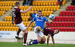 St Johnstone v Hearts...25.09.11   SPL Week 9.David McCracken clears from Ryan Stevenson and Gordon Scott.Picture by Graeme Hart..Copyright Perthshire Picture Agency.Tel: 01738 623350  Mobile: 07990 594431