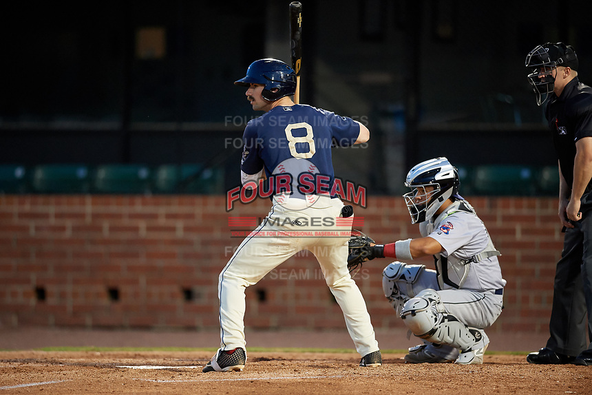 Mobile BayBears Brandon Sandoval (8) at bat in front of catcher Rodrigo Vigil (1) during a Southern League game against the Jacksonville Jumbo Shrimp on May 7, 2019 at Hank Aaron Stadium in Mobile, Alabama.  Mobile defeated Jacksonville 2-0.  (Mike Janes/Four Seam Images)