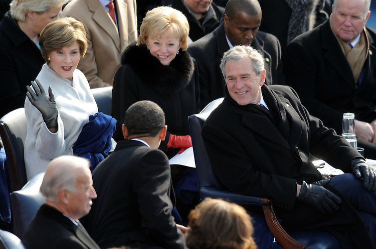 President Barack Obama talks with former First Lady Laura Bush and former President George W. Bush after being sworn in as the 44th president of the United States at the 56th Inaugural, January 20, 2009.