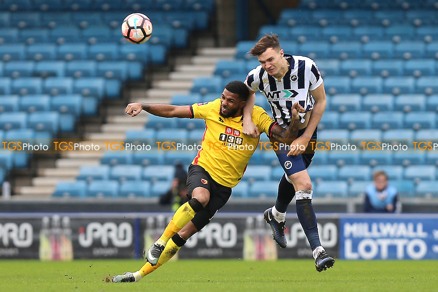 Jake Cooper of Millwall clears from Jerome Sinclair of Watford during Millwall vs Watford, Emirates FA Cup Football at The Den on 29th January 2017