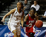 SIOUX FALLS MARCH 22:  Briana Burgins #3 of Francis Marion drives past Megan Mullings #11 of Alaska Anchorage during their quarterfinal game at the NCAA Women's Division II Elite 8 Tournament at the Sanford Pentagon in Sioux Falls, S.D. (Photo by Dick Carlson/Inertia)