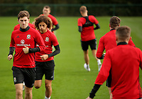 Pictured: Ben Davies (L) leads other players during warm up. Monday 02 October 2017<br /> Re: Wales football training, ahead of their FIFA Word Cup 2018 qualifier against Georgia, Vale Resort, near Cardiff, Wales, UK.