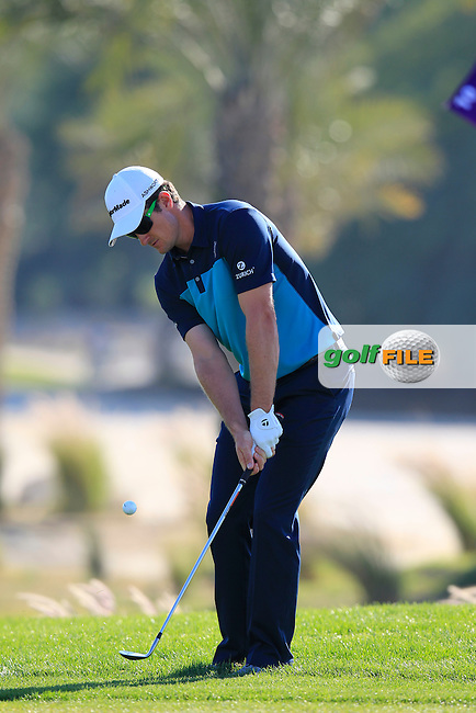 Justin Rose (ENG) chips onto the 10th green during Thursday's Round 2 of the 2015 Commercial Bank Qatar Masters held at Doha Golf Club, Doha, Qatar.: Picture Eoin Clarke, www.golffile.ie: 1/22/2015