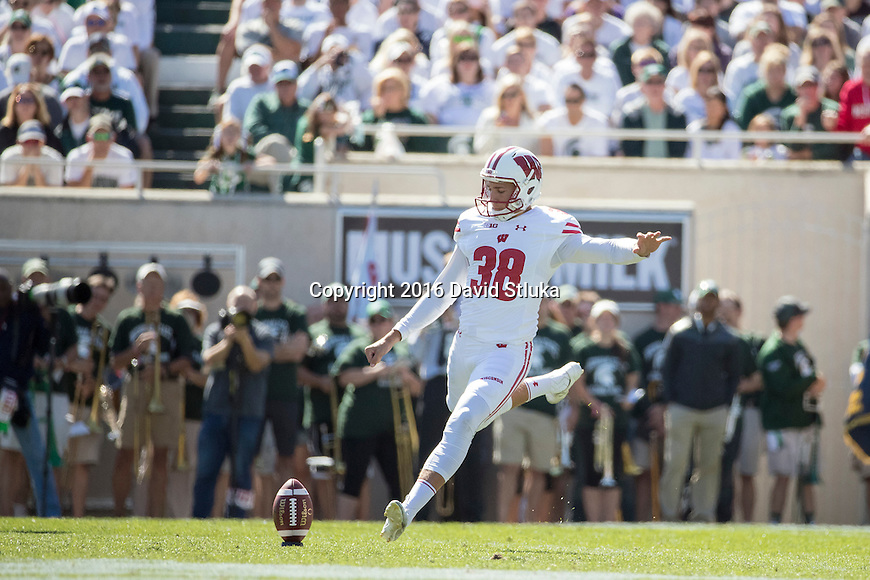 Wisconsin Badgers kicker P.J. Rosowski (38) kicks off during an NCAA college football game against the Michigan State Spartans Saturday, September 24, 2016, in East Lansing, Michigan.  (Photo by David Stluka)
