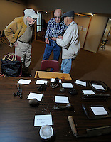 NWA Media/ J.T. Wampler -Gale Hairston, from the left, Ronald Pile and Harry Christen talk about their collections Wednesday Dec. 31, 2014 at the Shiloh Museum in Springdale.