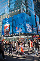 Advertising for Pepsi-Cola in Times Square in New York on Friday, December 13, 2013 promotes the company's sponsorship of the upcoming 48th Super Bowl.  (© Richard B. Levine)