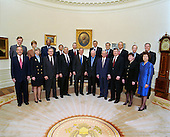 United States President George W. Bush's cabinet photographed on April 9, 2001 in the Oval Office of the White House in Washington, D.C.  First row, from left, Secretary of Commerce Donald Evans, Secretary of Interior Gale Norton, Secretary of Defense Donald Rumsfeld, Secretary of State Colin Powell, President George W. Bush, Vice President Dick Cheney, Secretary of Treasury Paul O'Neill, Attorney General John Ashcroft, Secretary of Agriculture Ann Veneman, Secretary of Labor Elaine Chao. Top row from left,.U.S. Trade Representative Robert Zoellick, Administrator of Environmental Protection Agency Christine Todd Whitman, Secretary of Education Roderick Paige, Secretary of Transportation Norman Mineta, Secretary of Health and Human Services Tommy Thompson, Secretary of Housing and Urban Development Mel Martinez, Secretary of Energy Spencer Abraham, Secretary of Veterans Affairs Anthony Principi, Director of the Office of Management and Budget Mitch Daniels, and Chief of Staff Andrew Card. .Mandatory Credit: Paul Morse - White House / CNP
