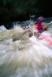 Kayaker braving the power of spring runoff, Rocky Mtns, CO