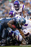 Seattle Seahawks running back Michael Robinson (26) breaks a tackle for a first down in a game against the Minnesota Vikings at CenturyLink Field in Seattle, Washington.