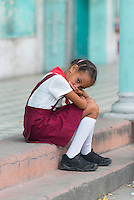 This is an image I took while in Cuba in 2013. This little girl was walking down the street with a relative in her school uniform and stopped for a rest when I snapped the picture.