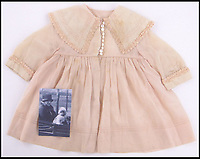 BNPS.co.uk (01202 558833)Pic: Burstow&amp;Hewett/BNPS<br /> <br /> Baby clothes being worn by Princess Elizabeth in the photograph.<br /> <br /> The Queen's garments given to her by the former royal nurse - Clara Knight<br /> <br /> Five of the Queen's dolls and a selection of her childhood clothes have emerged for sale.<br /> <br /> The garments and toys were given to the former royal nurse Clara Knight who looked after Queen Elizabeth in her early years while the Queen Mother was undertaking ceremonial duties.<br /> <br /> There are approximately 20 garments in the collection including infants dresses and matching undergarments, many in silks and linen and some in early man made fabrics.