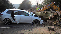 Pictured: An Audi car has been damaged by a falling tree in Menai Bridge, Anglesey, north Wales. Monday 13 February 2017<br /> Re: The Met Office has warned of very strong winds along the western coastlines of Wales throughout the day on Monday.<br /> It issued a yellow warning of wind, saying gusts of up to 75mph (120kmph) could occur locally, particularly to the west of the mountains.<br /> It added the unusual easterly direction could add to the impact of the winds.<br /> Forecasters said disruption to travel on roads and at sea was likely.