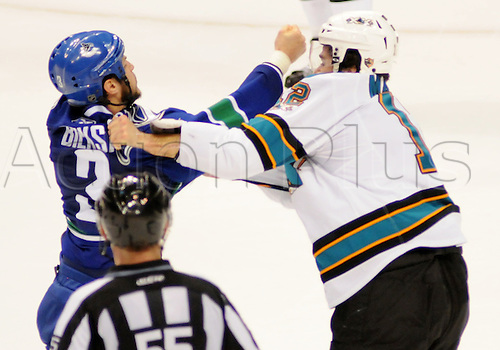 18.05.2011 Vancouver Canucks defender Kevin Bieksa (3) fights with San Jose Sharks forward Patrick Marleau (12) during the second period of game 2 of the Western Conference Finals in Vancouver, British Columbia on Wednesday night.