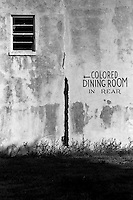 Exterior wall of decaying diner with sign for colored only dining room. Racism, bigotry, segregation. Texas City Texas USA.