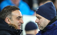 Swansea City Manaager Carlos Carvalhal with Spurs Manager Mauricio Pochettino during the Premier League match between Swansea City and Tottenham Hotspur at the Liberty Stadium, Swansea, Wales on 2 January 2018. Photo by Mark Hawkins / PRiME Media Images.