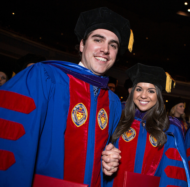 Students celebrate their graduation as the DePaul University College of Law held its commencement ceremony on May 17, 2015 at the Rosemont Theatre in Rosemont, IL, where some 280 students received their Juris Doctors or Master of Laws degrees. The Rev. Dennis H. Holtschneider, C.M., president of DePaul, conferred the degrees. M. Cherif Bassiouni, DePaul emeritus professor of law, addressed the graduating class and received an honorary degree. (DePaul University/Jeff Carrion)