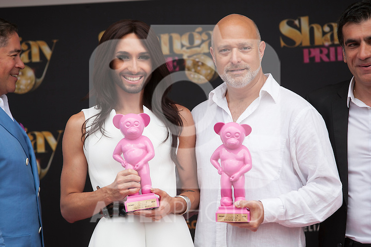 Austrian singer Conchita Wurst (L) and Stonewall 45 president Alan Reiff attend SHANGAY PRIDE and MADO Madrid Orgullo presentation and receives the Madrid Orgullo Muestra-T award in Madrid, Spain. July 03, 2013. (ALTERPHOTOS/Victor Blanco)