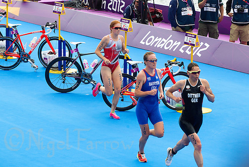 04 AUG 2012 - LONDON, GBR - Jessica Harrison (FRA) of France (left) and Anja Dittmer (GER) of Germany (centre) lap Paula Findlay (CAN) of Canada (right) as they run through transition for the start of another lap during the women's London 2012 Olympic Games Triathlon in Hyde Park in London, Great Britain .(PHOTO (C) 2012 NIGEL FARROW)