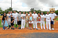 "16 May 2010:  FIU's Seniors (from left to right) Junior Arrojo (13), Tim Jobe (26), Corey Polizzano (6), Scott Rembisz (30), and Erik Berkowitz (2) are honored prior to the game with their families, Head Coach Henry ""Turtle"" Thomas and Roary.  The FIU Golden Panthers defeated the University of South Alabama Jaguars, 5-0, at University Park Stadium in Miami, Florida."