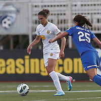 Western New York Flash midfielder Carli Lloyd (10) dribbles as Boston Breakers midfielder Jo Dragotta (25) defends. In a National Women's Soccer League Elite (NWSL) match, the Boston Breakers (blue) tied Western New York Flash (white), 2-2, at Dilboy Stadium on June 5, 2013.