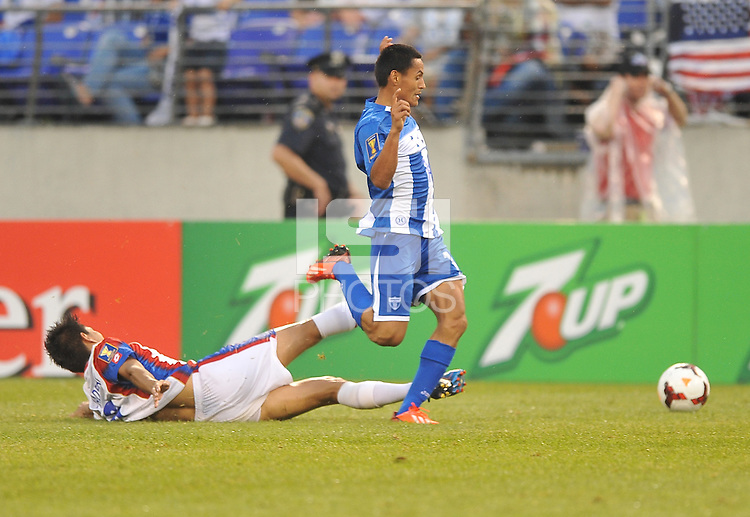 Andy Najar (14) of Honduras goes against Juan Diego Madrigal (6) of Costa Rica. Honduras defeated Costa Rica 1-0 at the quaterfinal game of the Concacaf Gold Cup, M&T Stadium, Sunday July 21 , 2013.