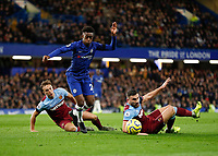 30th November 2019; Stamford Bridge, London, England; English Premier League Football, Chelsea versus West Ham United; Callum Hudson-Odoi of Chelsea dribbles past Mark Noble and Robert Snodgrass of West Ham United - Strictly Editorial Use Only. No use with unauthorized audio, video, data, fixture lists, club/league logos or 'live' services. Online in-match use limited to 120 images, no video emulation. No use in betting, games or single club/league/player publications