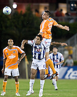 Houston Dynamo midfielder Geoff Cameron (20) goes up for the header over Pachuca FC midfielder Jaime Correa (5).  Houston Dynamo defeated Pachuca FC 2-0 in the semifinals of the Superliga 2008 tournament at Robertson Stadium in Houston, TX on July 29, 2008.