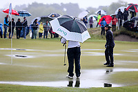 Puddles on the 1st green. McKayson NZ Women's Golf Open, Round Four, Windross Farm Golf Course, Manukau, Auckland, New Zealand, Sunday 1st October 2017.  Photo: Simon Watts/www.bwmedia.co.nz