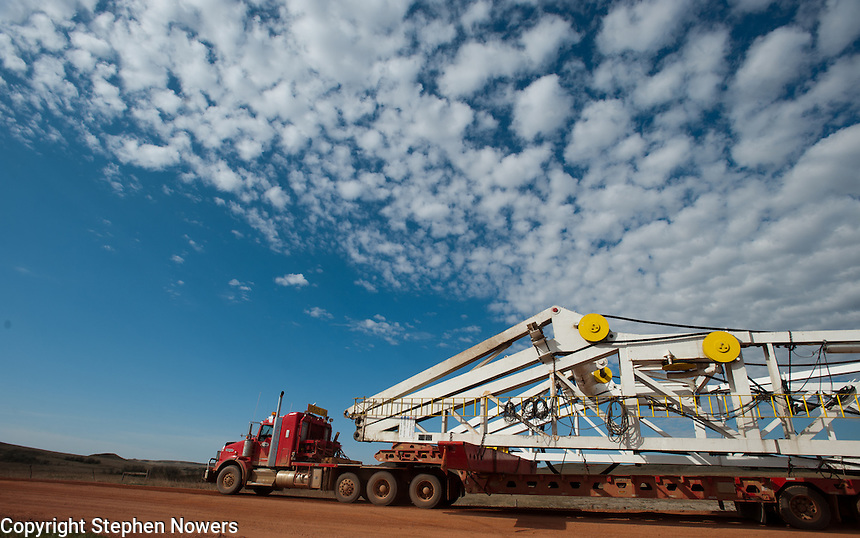 A Cruz Energy Services heavy haul truck moves an oil rig's derrick crown section to a new location in the Bakken field of North Dakota.