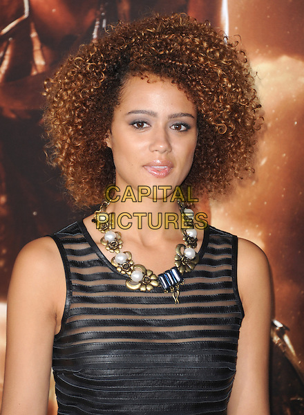 Nathalie Emmanuel<br />  at The Universal Pictures' World Premiere of 'Riddick' held at The Westwood Village in Westwood, California, USA, <br /> August 28th 2013.<br /> portrait headshot black striped gold necklace                                     <br /> CAP/DVS<br /> &copy;Debbie VanStory/Capital Pictures