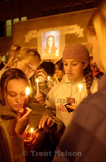 Students at East High School held a candlelight vigil for Madeline Lee Hales, a student who died recently from meningitis. A few of Hales' teachers spoke tributes to her youthful spirit, love of dance, and religious beliefs.<br />