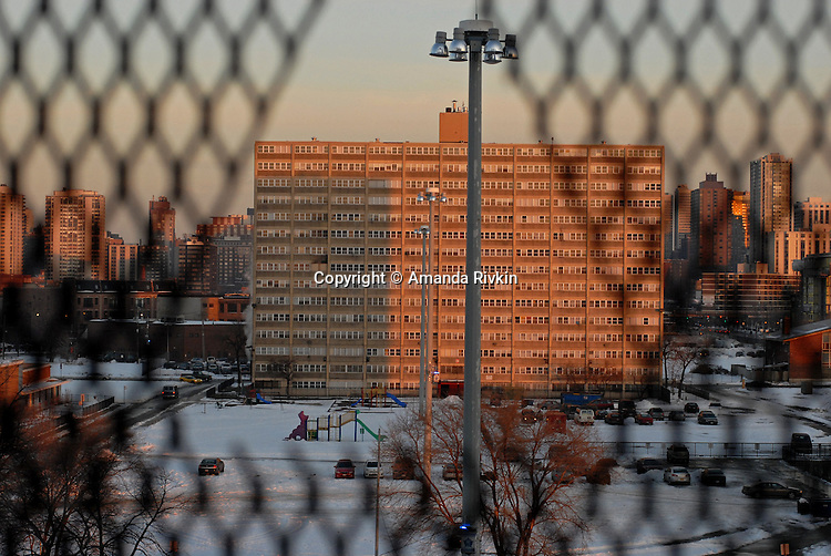 The view of a few of the remaining buildings left at the once sprawling Cabrini Green housing project on the Near North Side and the Chicago skyline from the corridor of a Cabrini Green high rise on the northeast corner of Halsted and Division Streets located at 1230 N. Burling in Chicago, Illinois on December 18, 2007.