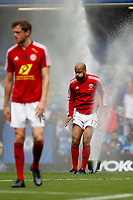 David McGoldrick of Sheffield United jumps through the sprinklers during the Premier League match between Chelsea and Sheff United at Stamford Bridge, London, England on 31 August 2019. Photo by Carlton Myrie / PRiME Media Images.