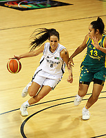 Ferns forward Natalie Purcell drives against Eva Afeaki during the International women's basketball match between NZ Tall Ferns and Australian Opals at Te Rauparaha Stadium, Porirua, Wellington, New Zealand on Monday 31 August 2009. Photo: Dave Lintott / lintottphoto.co.nz