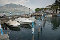 Speedboats at Isseo, Lake Iseo or Lago d'Iseo or Sebino is the fourth largest lake in Lombardy, Italy, fed by the Oglio river. It is in the north of the country in the Val Camonica area, near the cities of Brescia and Bergamo.