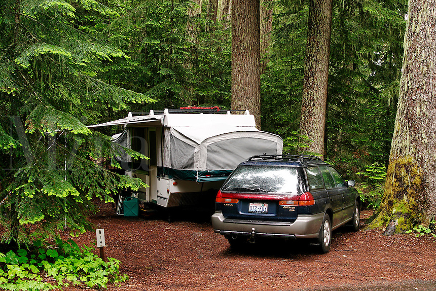 Car and tent trailer in forested campsite, White River Campground, Mount Rainier National Park, Washington, US