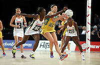 27.08.2016 South Africa's Bongiwe Msomi and Australia's Madi Robinson in action during the Netball Quad Series match between South Africa and Australia at Vector Arena in Auckland. Mandatory Photo Credit ©Michael Bradley.