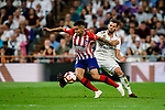Angel Correa of Atletico de Madrid (L) fights for the ball with Nacho Fernandez of Real Madrid (R) during their La Liga  2018-19 match between Real Madrid CF and Atletico de Madrid at Santiago Bernabeu on September 29 2018 in Madrid, Spain. Photo by Diego Souto / Power Sport Images
