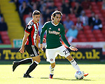 Jota of Brentford and Enda Stevens of Sheffield Utd  during the English Championship League match at Bramall Lane Stadium, Sheffield. Picture date: August 5th 2017. Pic credit should read: Simon Bellis/Sportimage