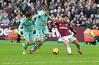 Felipe Anderson is tackled by Sokratis Papastathopoulos of Arsenal during West Ham United vs Arsenal, Premier League Football at The London Stadium on 12th January 2019