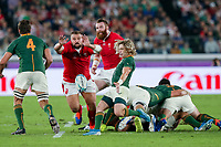27th October 2019, Oita, Japan;  Faf de Klerk of South Africa kicks as Tomas Francis of Wales tries to block during the 2019 Rugby World Cup semi-final match between Wales and South Africa at International Stadium Yokohama in Kanagawa, Japan on October 27, 2019.  - Editorial Use