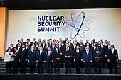 United States President Barack Obama, center, stands among other heads of state and attendees during a family photo at the Nuclear Security Summit in Washington, D.C., U.S., on Friday, April 1, 2016. After a spate of terrorist attacks from Europe to Africa, Obama is rallying international support during the summit for an effort to keep Islamic State and similar groups from obtaining nuclear material and other weapons of mass destruction. <br /> Credit: Andrew Harrer / Pool via CNP