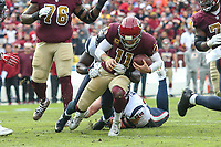 Landover, MD - November 18, 2018: Washington Redskins quarterback Alex Smith (11) gets sacked during the  game between Houston Texans and Washington Redskins at FedEx Field in Landover, MD.   (Photo by Elliott Brown/Media Images International)