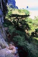 Female rock climber POV Railay Rei Lei, Thailand
