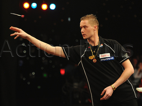 10.01.2013 Frimley Green, England.  Wesley Harms (NETH) (8) in action against Darryl Fitton (ENG) (16)  during the World Professional Darts Championships from the Lakeside Country Club.