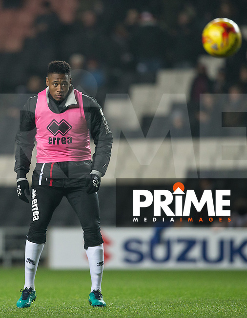 Chuks Aneke of Milton Keynes Dons warms up at half time during the Sky Bet League 1 match between MK Dons and Chesterfield at stadium:mk, Milton Keynes, England on 22 November 2016. Photo by Andy Rowland.